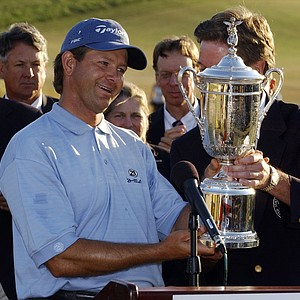 South Africa's Retief Goosen is given the championship trophy after his victory at the US Open golf tournament at Shinnecock Hills Golf Club in Southampton, N.Y. Sunday, June 20, 2004. This is Goosen's second US Open victory.