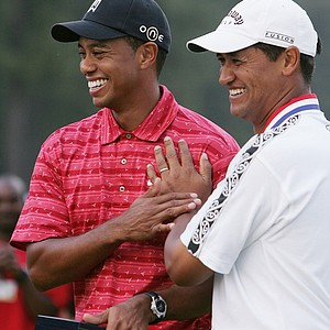 US Open winner Michael Campbell, right, of New Zealand, poses with Tiger Woods after the 105th US Open Championship at the Pinehurst Resort and Country Club's No. 2 course in Pinehurst, N.C., Sunday, June 19, 2005.