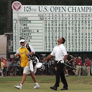 Michael Campbell of New Zealand walks onto the 18th green with his caddy, Michael Waite, during the final round of the 105th US Open Championship at the Pinehurst Resort and Country Club's No. 2 course in Pinehurst, N.C. Sunday, June 19, 2005. Campbell won the US Open.