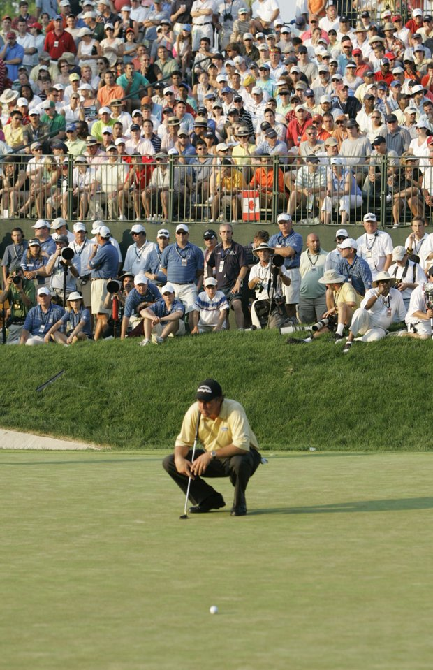 Phil Mickelson reacts on the 18th green after missing his chip for bogey during the final round of the U.S. Open golf tournament at Winged Foot Golf Club in Mamaroneck, N.Y., Sunday, June 18, 2006.