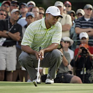 Tiger Woods lines up a birdie putt on 16 during the first round of the U.S. Open golf tournament at Winged Foot Golf Club in Mamaroneck, N.Y. Thursday 15, 2006. Woods missed the shot.