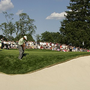 Tiger Woods hits from the sand on 13 during the first round of the U.S. Open golf tournament at Winged Foot Golf Club in Mamaroneck, N.Y. Thursday June15, 2006.