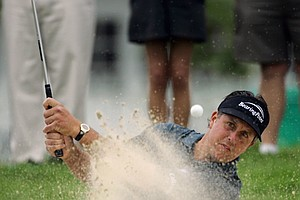 Phil Mickelson hits out of a bunker on the 12th hole during the first round of the U.S. Open golf tournament at Winged Foot Golf Club in Mamaroneck, N.Y., Thursday, June 15, 2006. Mickelson bogeyed the hole.