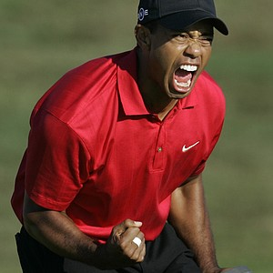 Tiger Woods reacts after sinking a birdie putt on the 18th green forcing a playoff against Rocco Mediate during the fourth round of the US Open championship at Torrey Pines Golf Course on Sunday, June 15, 2008 in San Diego.