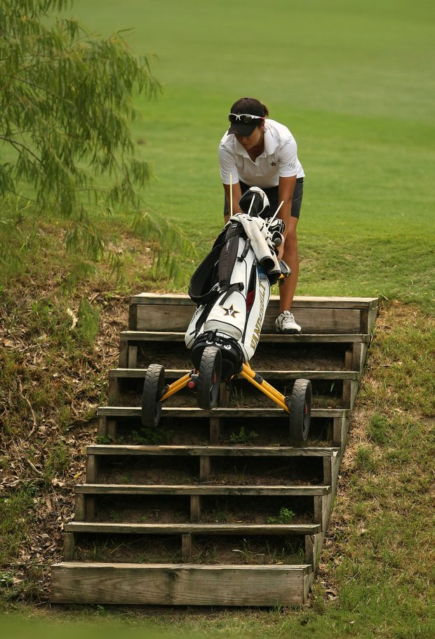 Vanderbilt's Marina Alex takes her push cart down a set of stairs at No. 8.