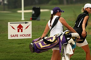 Purdue's Thea Hoffmeister and LSU's Tessa Teachman head to the safe house near the 9th hole after the horns were sounded during Round 3. Play resumed shortly after 5 p.m.