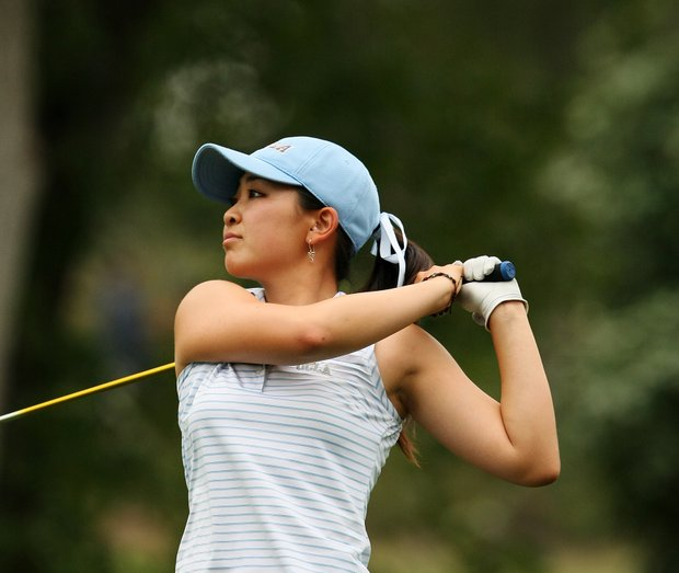 UCLA's Tiffany Lua hits her tee shot at No. 9. Lua made a hole-in-one at No. 11.