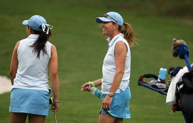 UCLA's Carrie Forsyth talks with her player Tiffany Lua during Round 3. At the end of the day, UCLA held the lead.
