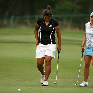 Purdue's Numa Gulyanamitta misses her par putt at No. 9 as UCLA's Tiffany Lua watches during Round 3. As played was called with four holes to play, UCLA had the lead.