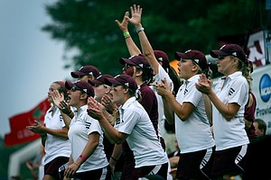 Texas A&M players cheer during the third round of the 2011 NCAA Championship.