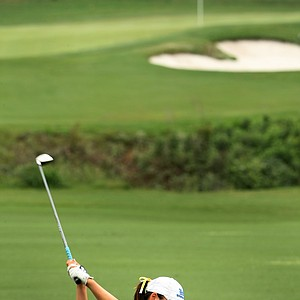 UCLA's Tiffany Lua hits her second shot at No. 1 during the final round at Women's NCAA Championship.