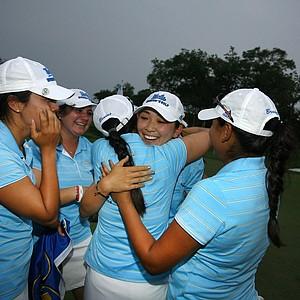 UCLA's Tiffany Lua gets hugs after the UCLA Bruins won the 2011 NCAA Women's Division I Naitonal Championship.
