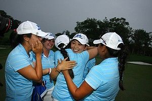 UCLA's Tiffany Lua gets hugs after the UCLA Bruins won the 2011 NCAA Women's Division I Naitonal Championship.
