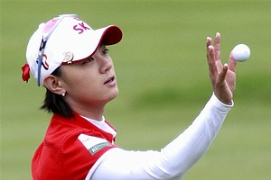 Na Yeon Choi, of South Korea, catches her ball that was tossed to her after missing a putt on the ninth hole during a semifinal round match against Suzann Pettersen, of Norway, in the LPGA Sybase Match Play Championship at Hamilton Farm GC, Sunday, May 22, 2011, in Gladstone, N.J.