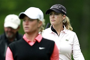 Cristie Kerr, right and Suzann Pettersen, of Norway, walk away after teeing off the eight hole during the championship match in the LPGA Sybase Match Play Championship golf tournament at Hamilton Farm GC, Sunday, May 22, 2011 in Gladstone, N.J.