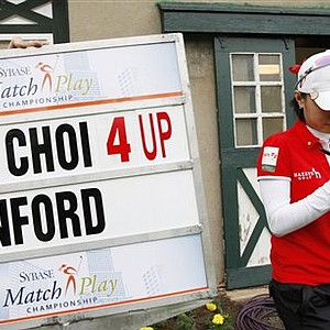 Na Yeon Choi signs a game ball after she beat Angela Stanford in the consolation match of the LPGA Sybase Match Play Championship at Hamilton Farm GC, Sunday, May 22, 2011 in Gladstone, N.J.