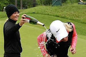 Suzann Pettersen, right, of Norway, gets a champagne shower from pro golfer Anna Nordqvist, of Sweden, after Pettersen beat Cristie Kerr in the championship round in the LPGA Sybase Match Play Championship at Hamilton Farm GC, Sunday, May 22, 2011 in Gladstone, N.J.
