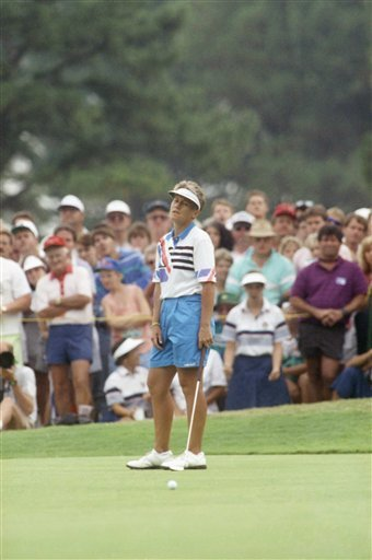 Patty Sheehan sags as her putt for a birdie on the final hole of the U.S. Women's Open fails to fall, July 16, 1990 in Duluth, Ga. Sheehan let an eight-shot lead slip away over the last 23 holes of the rain-plagued tournament which was won by Betsy King.