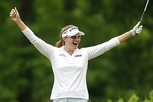 Brittany Lang celebrates after hitting a hole-in-one on the eighth hole during the first round of Match Play Classic on Thursday, May 19, 2011.
