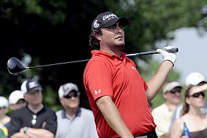 Steven Bowditch, of Australia, watches his tee shot on the 14th hole during the third round of play at the Colonial golf tournament in Fort Worth, Texas, Saturday, May 21, 2011.