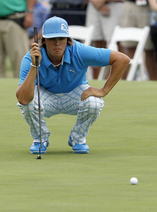 Rickie Fowler lines up a putt on the ninth hole during the first round at the Crowne Plaza Invitational at Colonial golf tournament Thursday, May 19, 2011 in Fort Worth, Texas.