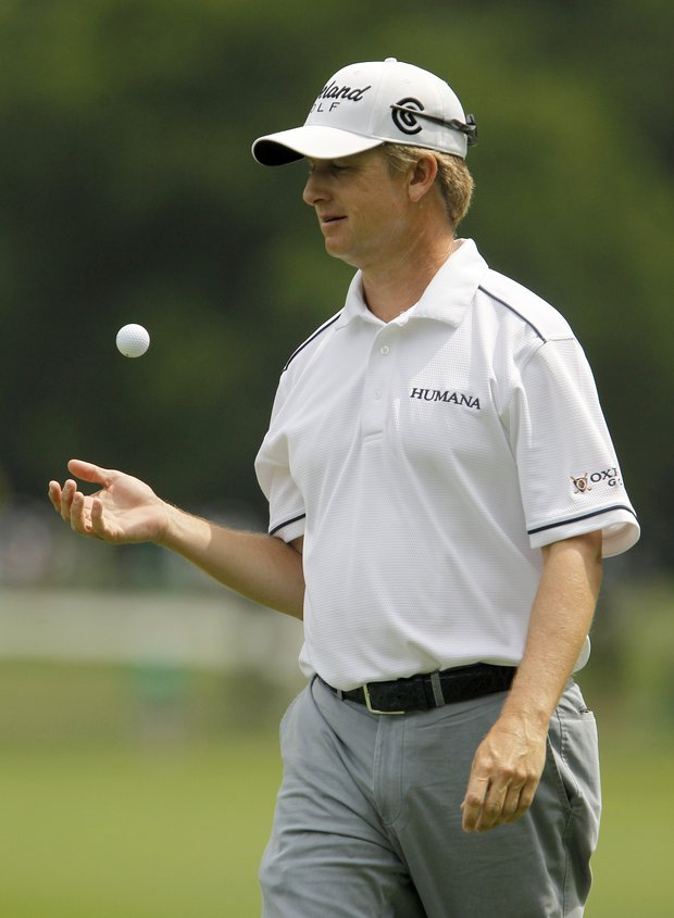 David Toms tosses the ball after sinking a putt on the sixth hole during the first round at the Crowne Plaza Invitational at Colonial golf tournament, Thursday, May 19, 2011, in Fort Worth, Texas.
