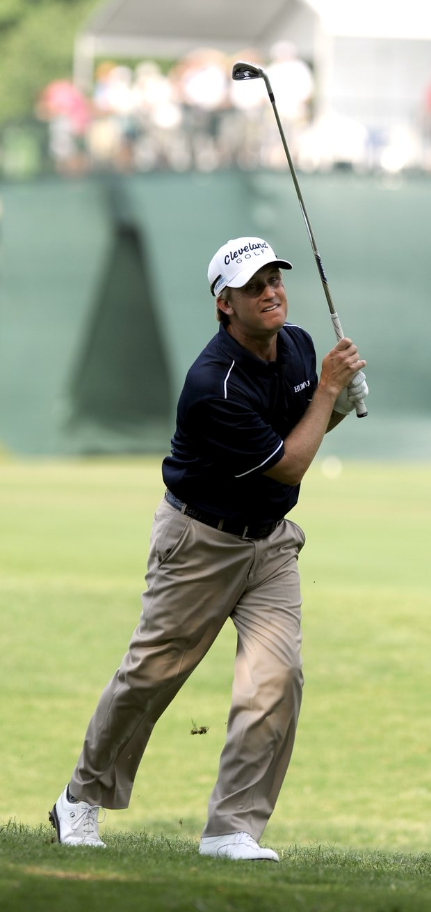 David Toms follows his shot out of the rough on the 17th hole during the third round of play at the Colonial golf tournament in Fort Worth, Texas, Saturday, May 21, 2011.