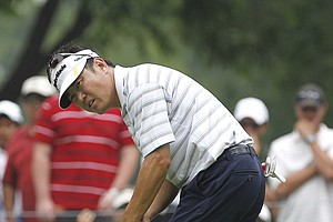 Charlie Wi, of South Korea, watches his putt on the fourth hole during the final round of the Colonial golf tournament in Fort Worth, Texas, Sunday, May 22, 2011.