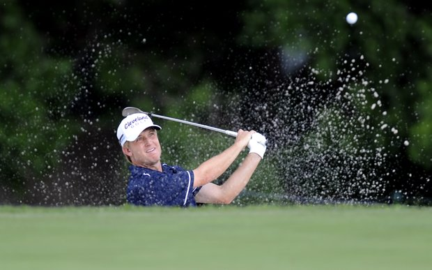 David Toms hits out of a bunker on the 17th hole during the third round of play at the Colonial golf tournament in Fort Worth, Texas, Saturday, May 21, 2011.