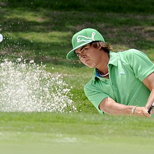 Rickie Fowler hits out of a bunker on the first hole during the third round of the Colonial golf tournament in Fort Worth, Texas, Saturday, May 21, 2011.