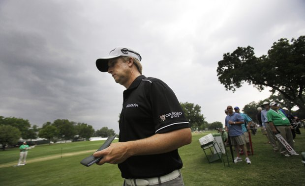 With rain clouds looming David Toms heads to the 11th tee during the second round of play at the Colonial golf tournament in Fort Worth, Texas, Friday, May 20, 2011. Play was suspended due to the weather.