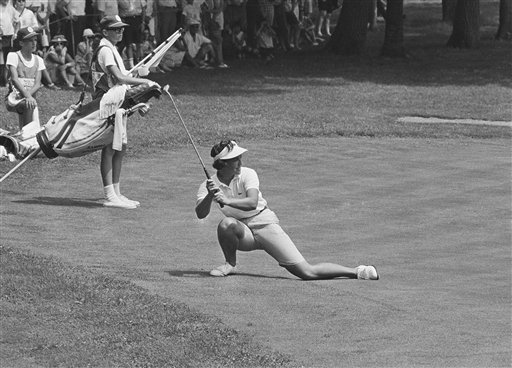 Sandra Spuzich bends low as she watches ball miss the cup on 7th green at Hazeltine National GC in Minneapolis Sunday, July 4, 1966, during the final round of the 1966 U.S. Woman's Open championship. Spuzich, 29, won the championship with a nine over par 297 for 72 holes. She finished one stroke ahead of defending Women's Open champion Carol Mann.