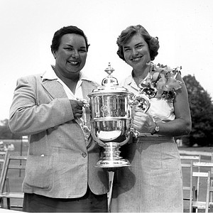 Golfers Betsy Rawls, right, and Jackie Pung pose with the winner's trophy at the Country Club of Rochester in Rochester, N.Y. on June 28, 1953. Rawls won the U.S. Women's Open Golf Championship by 6 strokes. Pung finished second.