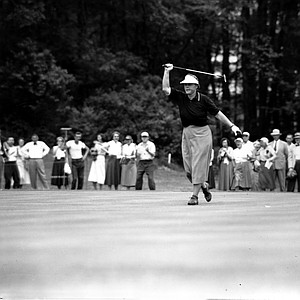 Patty Berg helps her long putt on the 4th green, which she made for a birdie, at the U.S. Women's Open Golf tournament at the Rochester Country Club in Rochester, N.Y. on June 26, 1953. Berg finished with a 73-one under par in today's round.