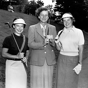 Golfers Betty Hicks, Babe Zaharias and Betsy Rawls pose together before starting round in the U.S. Women's Open National Golf Championship at the Salem Country Club in Peabody, Mass., on July 1, 1954. A total of 21 pros and 32 amateurs started play today in the three-day event.