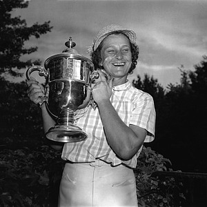 Babe Didrikson Zaharias poses with her Women's U.S. Open Golf Championship trophy cup at Salem Country Club in Peabody, Ma., July 3, 1954. The Babe led the three-day tournament for a 291 total over the rugged 6,393 yard and won by 12 strokes.