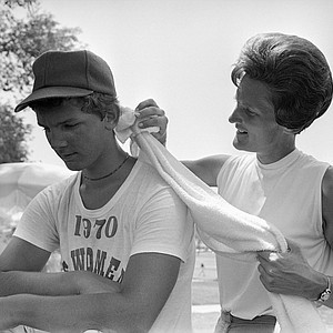 Golfer Kathy Whitworth rubs her Caddy down with a wet towel after the first round of action in the U.S. Womens Open Golf Tourney, July 3, 1970, Muskogee, Okla. The temperature was over the century mark. Miss Whitworth is the leading money-winner on the ladies professional golf tour for year. The caddy is unidentified.