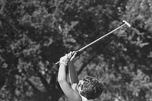 Donna Caponi, N. Hollywood, Calif., dances and waves her putter after sinking the putt on 18th green that gave her a second consecutive win of the U.S. Women's Open Golf Championship in Muskogee, on July 5, 1970.