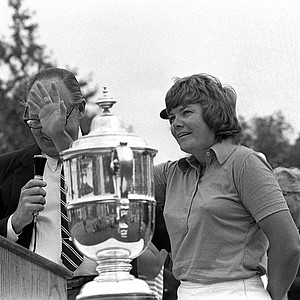 Sandra Haynie of Dallas, Texas, accepts a trophy for winning the U.S. Women's Open Golf Tournament in La Grange, Ill., Sunday, July 22, 1974.