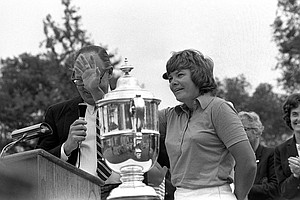 Sandra Haynie of Dallas, Texas, accepts a trophy for winning the U.S. Women's Open Golf Tournament in La Grange, Ill., Sunday, July 22, 1974.