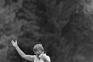 Joanne Carner drops to the green after sinking a putt on the 17th hole as she wins a playoff against Sandra Palmer for the U.S. Women's Open golf tournament in suburban Philadelphia, Pa., on July 12, 1976.