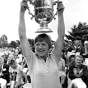 JoAnne Carner shows her trophy after winning the U.S. Women's Open Golf Tournment in suburban Philadelphia, Pa., Monday, July 12, 1976.