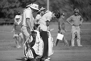 Golfer Kathy Whitworth, right, took her eyes off the game for a few moments as she waited to take her second shot at the U.S. Womens Open, Hazeltine National Golf Course, July 23, 1977, Chaska, Minn. At left is Golfer Nancy Lopez.