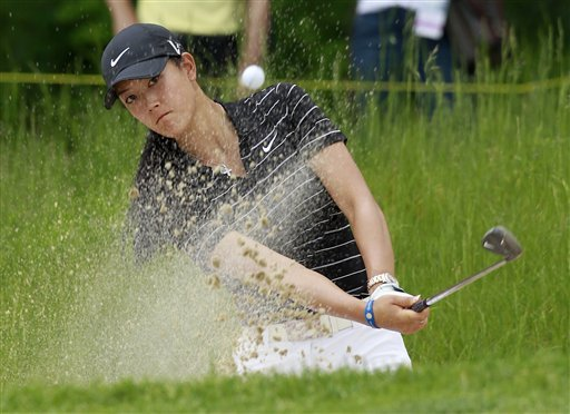 Michelle Wie hits out of a bunker on the 18th hole during a third-round match against Sophie Gustafson in the LPGA's Sybase Match Play Championship on May 21, 2011.