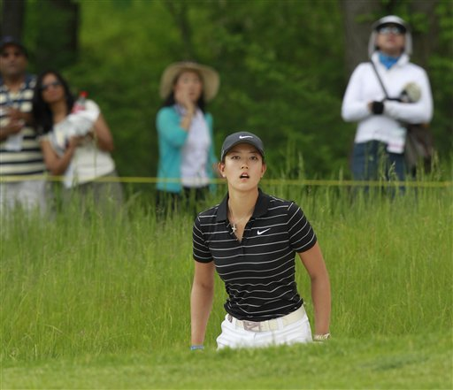 Michelle Wie looks watches her shot after hitting out of a bunker on the 18th hole during a third-round match against Sophie Gustafson, of Sweden, in the LPGA's Sybase Match Play Championship golf tournament at Hamilton Farm Golf Club, Saturday, May 21, 2011, in Gladstone, N.J.