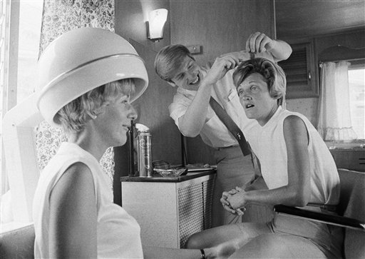 Golfer Kathy Whitworth, right, has her hair styled by Frank Long as Carol Mann dries her hair in a dryer following practice rounds at the U.S. Womens Open in Moselem Springs CC, July 3, 1968, Reading, Pa.