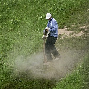 A course worker spreads a drying agent on a hill off the eighth tee box during the LPGA Sybase Match Play Championship golf tournament at Hamilton Farm Golf Club, Friday, May 20, 2011 in Gladstone, N.J.