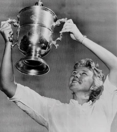 Mickey Wright sports her fourth U.S. Open Women's Golf Championship trophy after defeating Ruth Jessen 72-70 in an 18-hole playoff in this July 13, 1964 photo at San Diego CC.