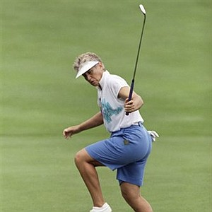 Patty Sheehan jumps as her birdie putt rolls into the cup on the 18th green at Indianwood Golf and CC in Lake Orion, Mich., July 21, 1994 during first round U.S. Women's Open. The birdie gave Sheehan a 5-under par score of 66 for the round. Sheehan won the Open in 1992.