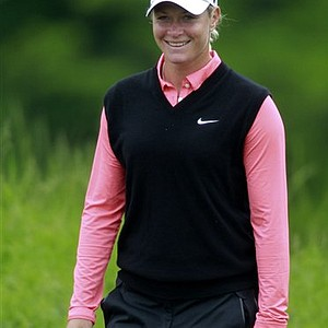 Suzann Pettersen, of Norway, smiles as she walks away from the second tee during the championship match against Cristie Kerr in the LPGA Sybase Match Play Championship golf tournament at Hamilton Farm GC, Sunday, May 22, 2011 in Gladstone, N.J.